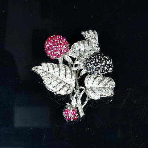A ruby, sapphire, garnet and diamond brooch, by Bulgari,