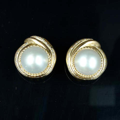 A pair of cultured pearl and diamond earclips, by Tiffany and Co.,