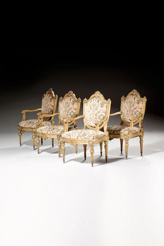 A set of four late 18th Century Italian carved giltwood Fauteuils,