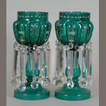 A pair of Victorian green glass table lustres