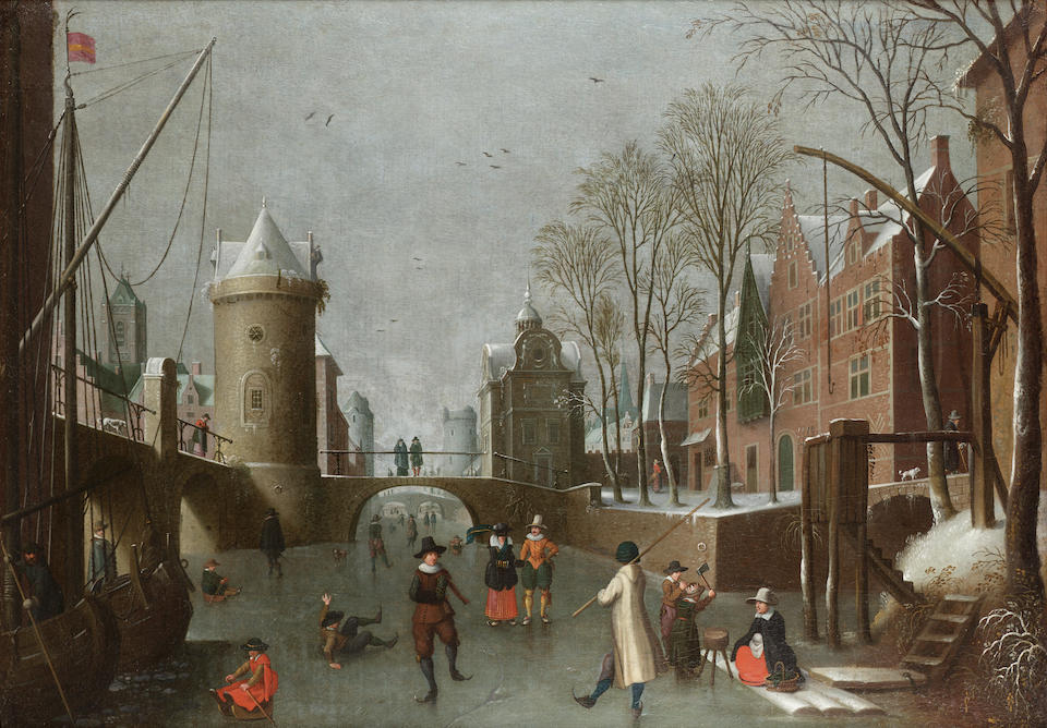 Circle of Sebastian Vrancx (Antwerp 1573-1647) A winter townscape with figures skating on a frozen c