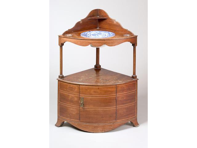 A George III mahogany bow front corner washstand,