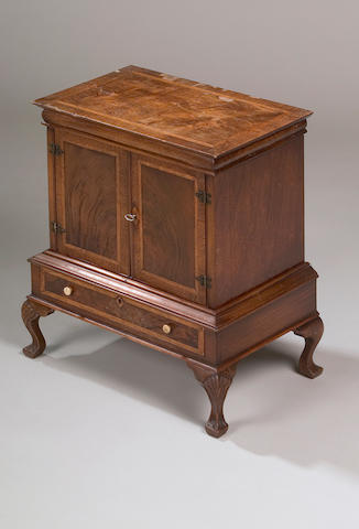 A reproduction George I style walnut miniature cabinet on stand,