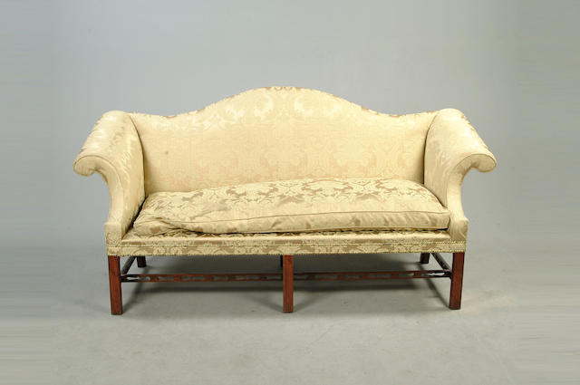 A pair of George III style mahogany sofas