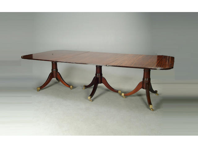 A Regency style mahogany four pedestal dining table