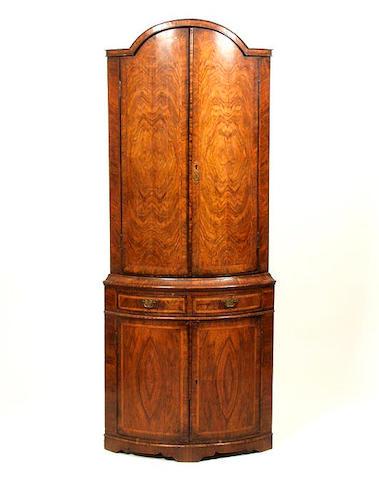 A Queen Anne style walnut floor standing corner cabinet