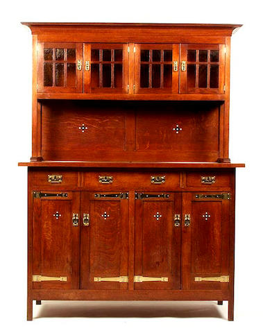 A German Art Nouveau oak dining suite
