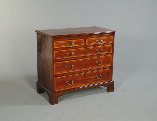 A George III mahogany and satinwood crossbanded chest