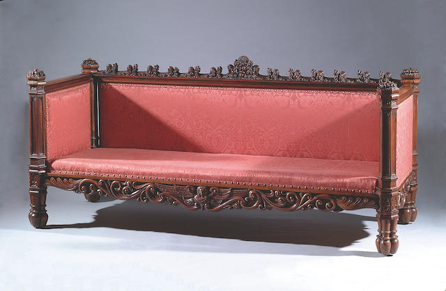 A Victorian carved mahogany gothic sofa, in the manner of Richard Bridgens,