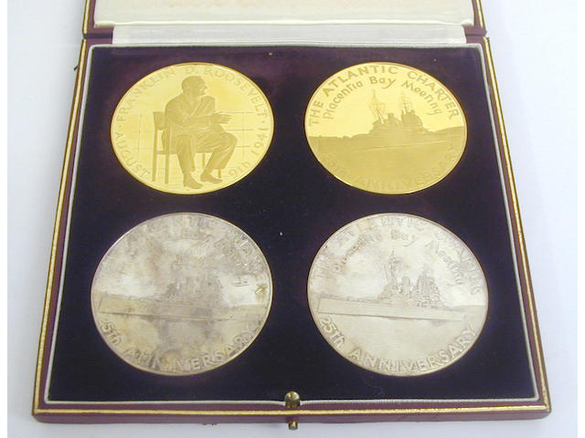 "Sir Winston Churchill and Franklin D Roosevelt 25th Anniversary Atlantic Charter Commemorative medal set, comprising two 22 carat gold medals, numbered ""A10"" and two silver examples ""A10"", cased."