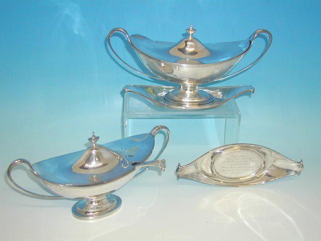 A pair of Scottish twin handled sauce tureens, with matching stands and ladles, by Hamilton and Inches Edinburgh, 1910,