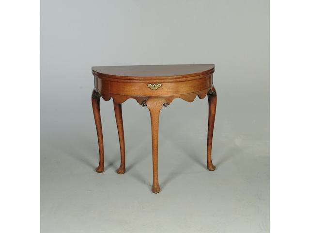 A George II walnut demi line tea table