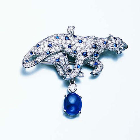A sapphire and diamond brooch/pendant by Cartier