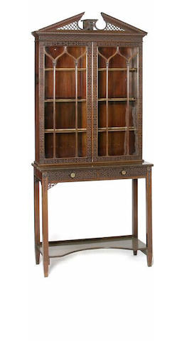 An Edwardian mahogany display cabinet, by Edwards and Roberts,