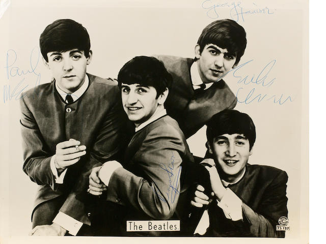 An autographed publicity photograph of the Beatles, 1964,