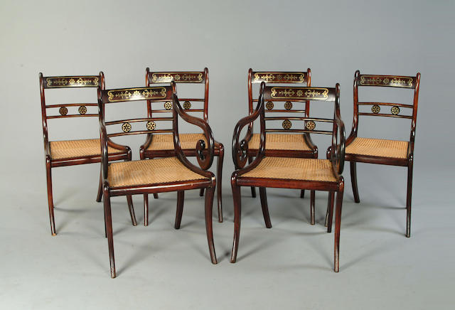 A set of six Regency rosewood grained and brass inlaid chairs
