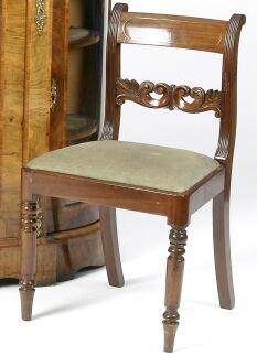 A set of six early 19th Century mahogany dining chairs,