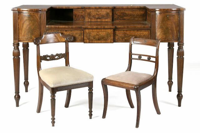 A Regency mahogany and ebony line inlaid sideboard,