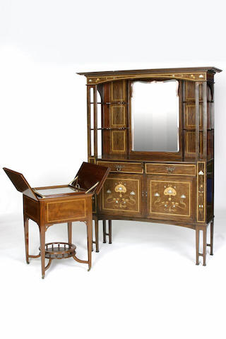An Art Nouveau mahogany inlaid display cabinet