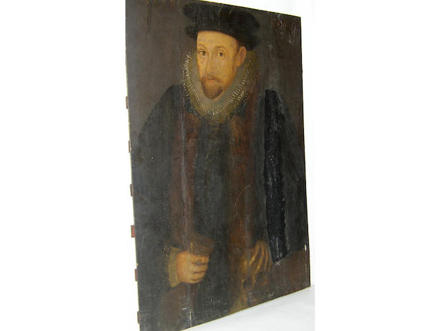 English School circa 1598 Portrait of a gentleman aged 50, half length, standing, wearing a fur trimmed dark coat, white ruff amd black hat, his hand resting on a skullinscribed and dated 'Aet. suae 50 1598', oil on panels (cradled), 73 x 55.5cm (28¾ x 21¾in) (unframed)