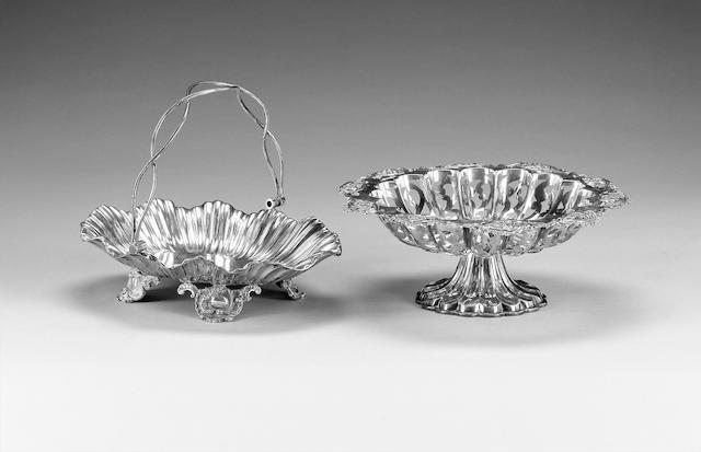 An Edwardian silver swing-handled fruit basket, by Walker & Hall, Sheffield 1904, and an Edwardain silver fruit bowl with pierced decoration.