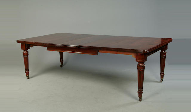 A late Victorian mahogany extending dining table