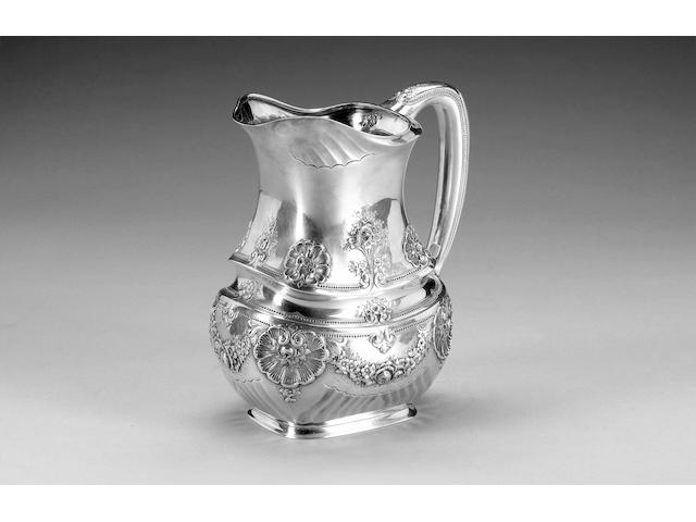 An American silver pitcher by Tiffany & Co., incuse stamped on base with maker's mark, also stamped with English import marks for London 1936,