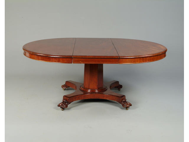 A Victorian mahogany extending circular dining table