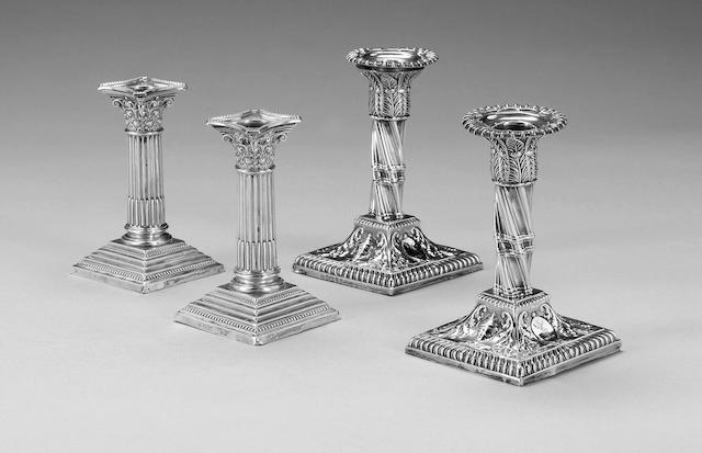 A pair of Edwardian silver dwarf Corinthian column candlesticks, Sheffield 1902, and a single silver candlestick. (3)