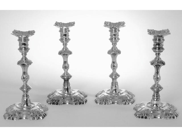 A matched set of four George II cast candlesticks, by William Gould, London 1748 (2) and 1749 (2),