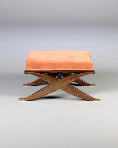 A Macassar ebony X-frame stool designed by Ruhlmann