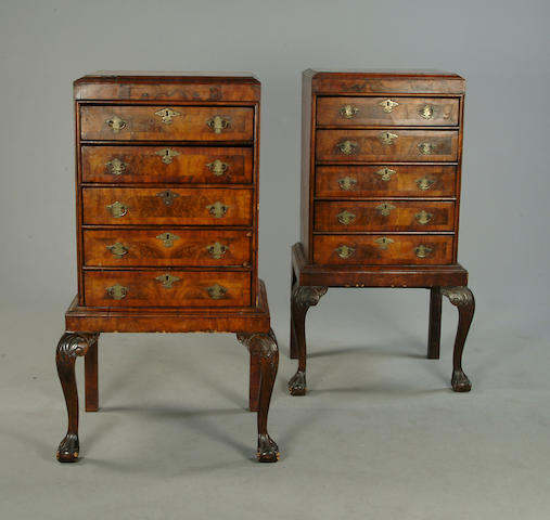 A pair of walnut and cross banded chests on stands