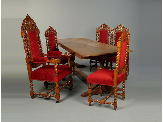 A 19th Century carved oak dining suite comprising; ten dining cahirs to include two elbow chairs, a