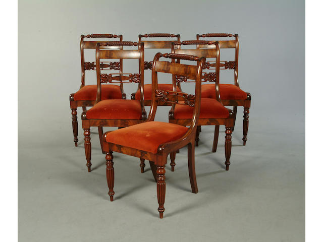 A set of six late Regency mahogany and brass strung dining chairs