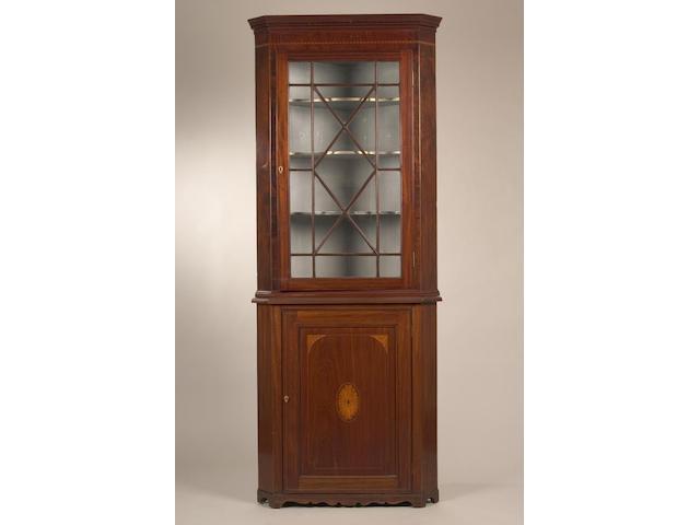 A 19th Century mahogany floorstanding corner cupboard,