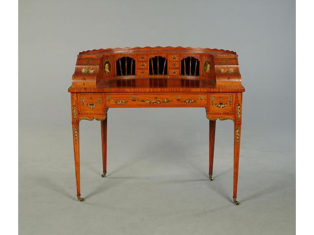 An Edwardian satinwood 'Carlton House' style desk