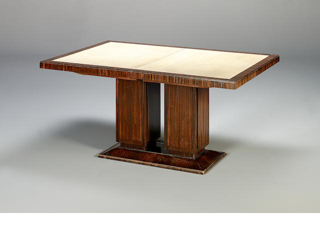 A Macassar ebony dining table with an additional leaf concealed below, with leather inset top, 153cm