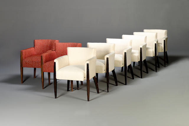 A set of eight Macassar ebony framed tub shaped dining chairs designed by Ruhlmann
