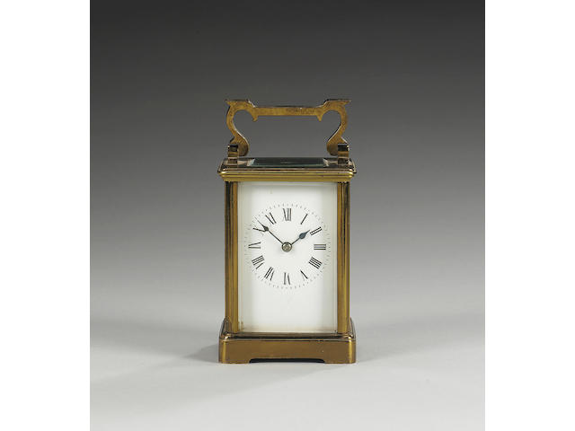 A late 19th Century French lacquered brass carriage clock,
