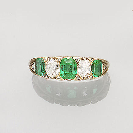 A late Victorian emerald and diamond ring