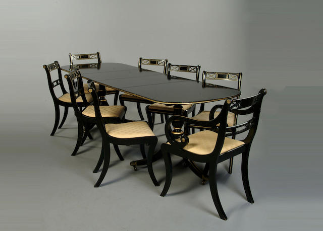 A Regency style ebonised and gilt dining room suite