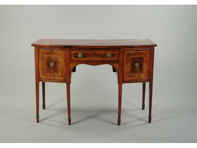 A George III mahogany and satinwood bow front sideboard
