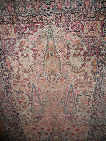 A Kirman rug South East Persia, 224cm x 143cm