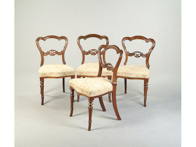 A set of four Victorian rosewood balloon back dining chairs