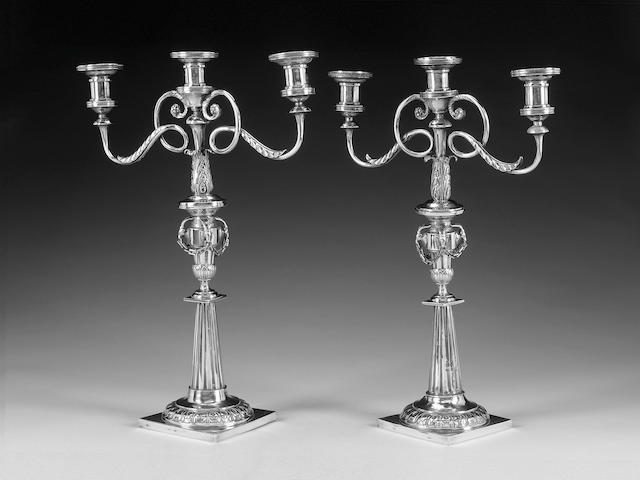 A pair of composite German silver candelabra comprising two late 18th century German candlesticks, by Johann Rudolf Haller, Augsburg, 1785/87,