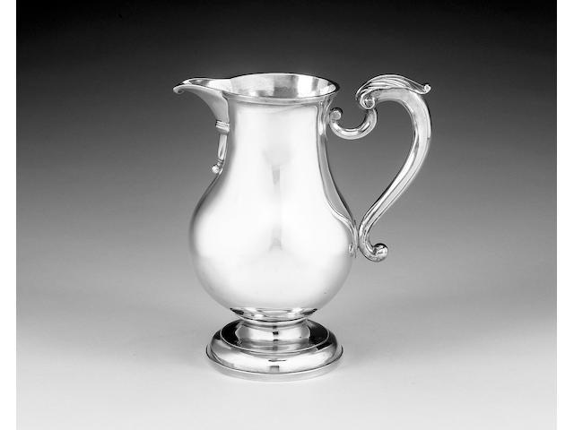 A George II silver beer jug, by John Berthellot, London 1752,