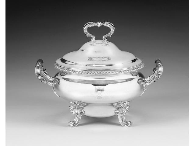 A George III silver two-handled soup tureen and cover, by Robert Garrard, London 1815,