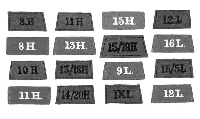 WWI and WWII cloth slip-on shoulder titles