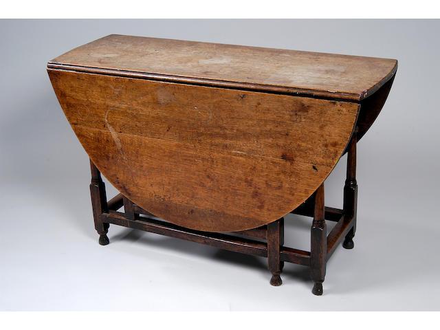 An 18th Century oak gate-leg table,