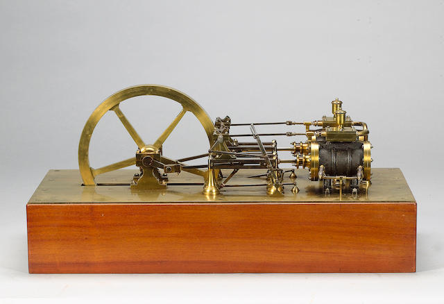 An extremely fine polished brass and wrought iron model of a reversing twin-cylinder horizontal stationary steam engine